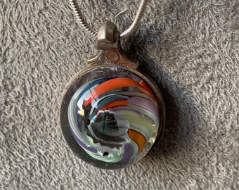 Flute key and melted marble pendant