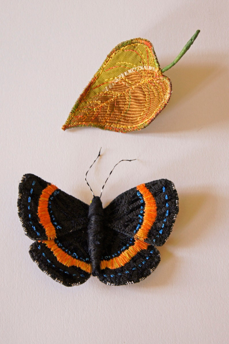 black Amazonian Metalmark butterfly and leaf Set of two embroidered brooches