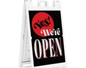 """Sidewalk Sign for business - Deluxe Signicade® Sidewalk Sign with double-facing """"Yes, We're Open"""" inserts signs."""