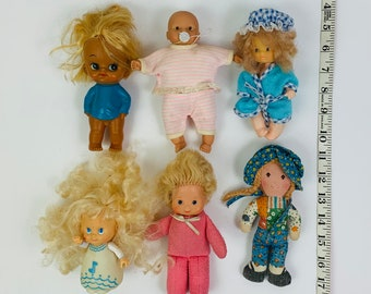 Six small dolls, Hollie Hobbie doll, Fisher Price doll, Marchon doll, 3 unmarked doll with clothing