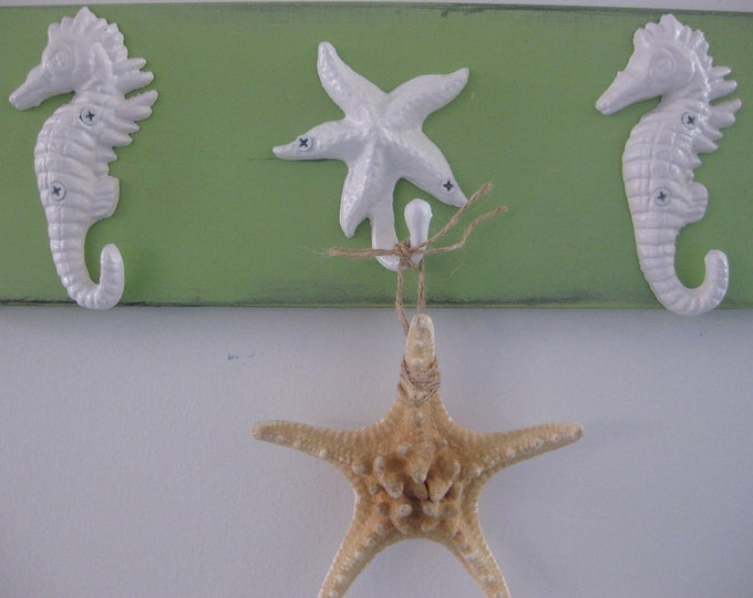 pool towel rack hot tub outside shower starfish seahorses towel hooks nautical coastal decor wall art interior design BeachHouseDreamsHome