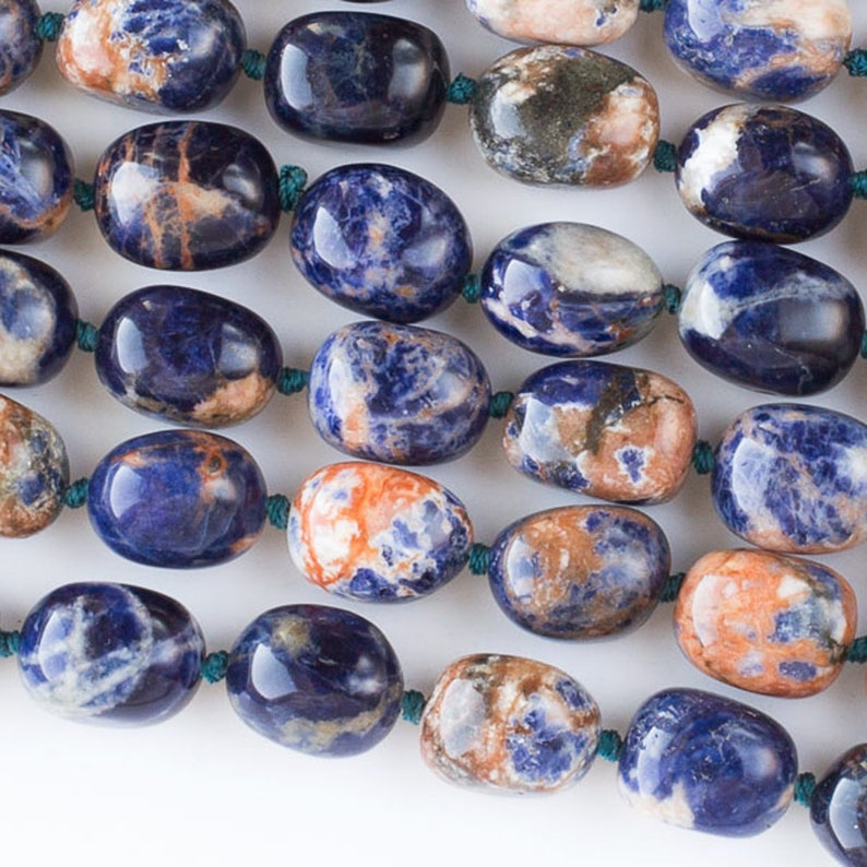 One 16 inch strand of 12x16mm Orange and Blue Sodalite polished free-form beads like little sodalite potatoes