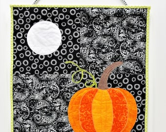 """Pumpkin wall quilt- autumn, fall wall hanging- art quilt """"under the harvest moon"""" black with bright pumpkin and full moon Ready to Ship"""