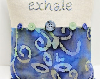 """Hand-embroidered pillow  """"exhale"""" in blue and green on natural linen with blue and green batik, ready to ship"""