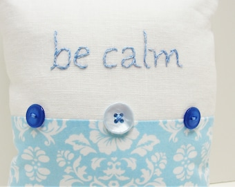 """hand-embroidered pillow - """"be calm"""" in blue and white on white linen with floral print- serene, calm, meditation, tranquility, ready to ship"""