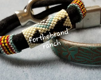 Jordan's Arrow Beaded Bracelet on Black Suede Leather