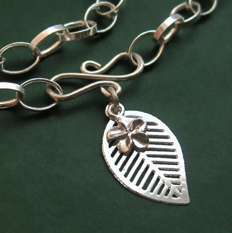 Sterling Silver Charm Bracelet With Leaf Flower and Infinity image 0