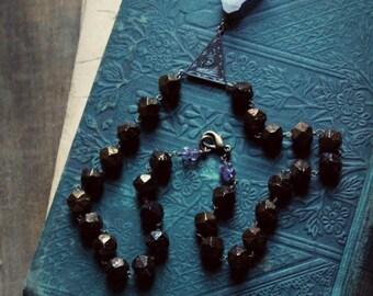 Myrddin. Raw Amethyst Crystal Point and Antique Hand Cut Glass Bead Necklace.