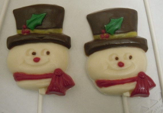 A dozen Snowman head lollipops
