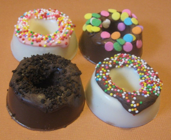 One dozen chocolate candy mini donuts with sprinkles