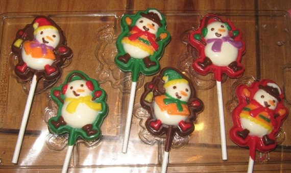 One dozen snowmen lollipop suckers