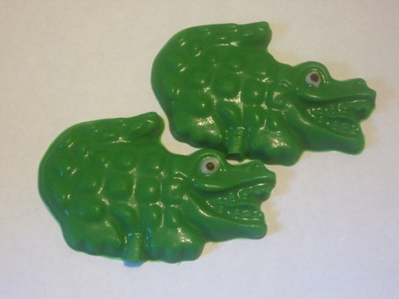 One dozen chocolate alligator candy pieces or lollipops