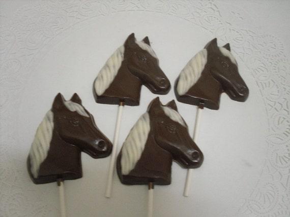 A dozen horse head lollipops