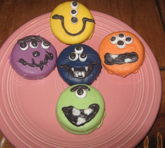 One dozen alien funny face chocolate covered sandwich cookies
