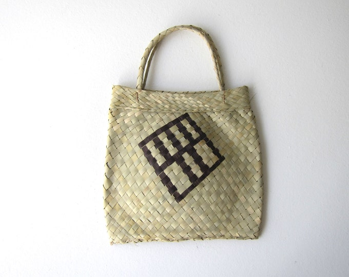 small handwoven palm leaf tote