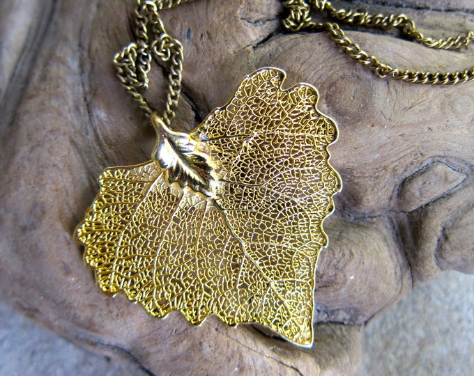 filigree gold leaf necklace 80s nature lovers fall leaf necklace vintage jewelry