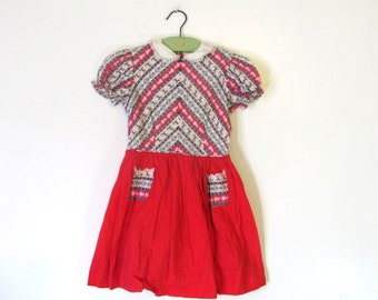 1950s Vintage Little Girls Dress // red and white print with reindeer and dutch girls // childs