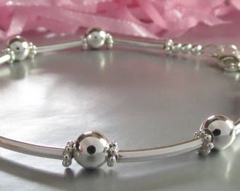 Sterling Silver Beaded Layering Bracelet with Spacer Tubes and Daisy Spacers. Personalized Hand Stamped Initial Charm.  Anniversary Gift.