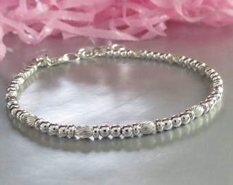 Sterling Silver Fancy Bead Stacking Bracelet with Textured Beads and Personalized Hand Stamped Initial Charm. Adjustable Layering Arm Candy.