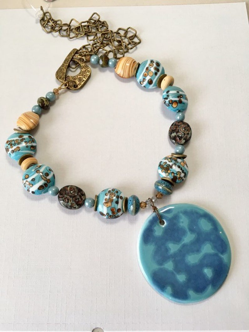 N-221 Statement Necklace Blue Ceramic and Aqua and Bronze Lampwork Glass on Antique Brass