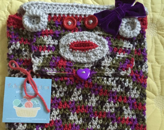Sock Monkey Backpack Crocheted in a striping yarn with purple, red, green, brown, and linen—FREE Shipping