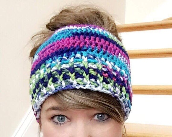 Messy Bun/Ponytail Hat with tall ribbed rim in Jazz yarn, very colorful