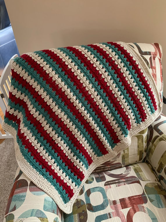 Baby Blanket/Afghan in crimson, cream, and teal that is also great holiday accent
