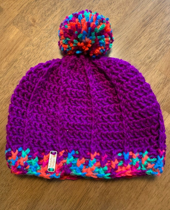 Neon Purple Youth Pom Hat with unique stitch and ribbed cuff. FREE SHIPPING!