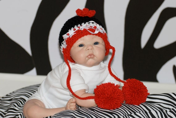 Black, red, and white hat with long braids and pom poms with ladybug ribbon FREE SHIPPING