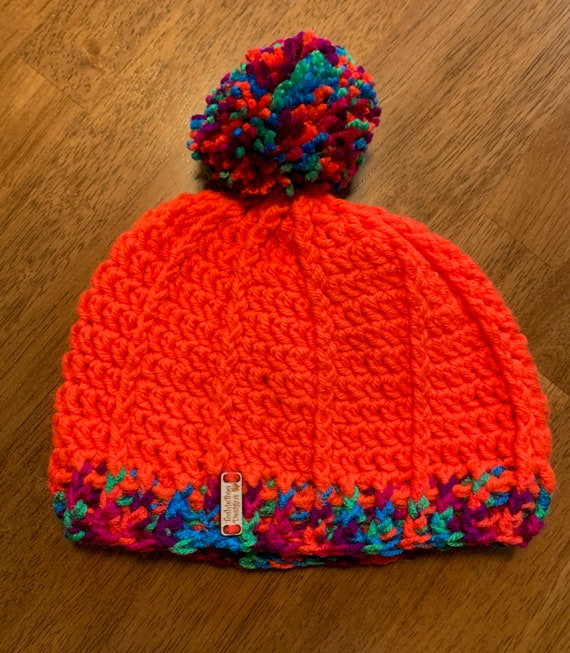 YOUTH unique pattern neon orange with multiple color pom pom and ribbed band. FREE SHIPPING.
