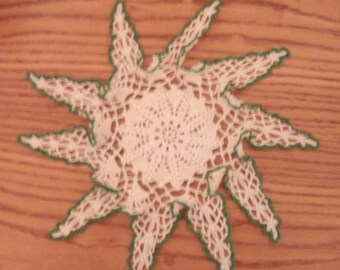 Green and white crochet doily