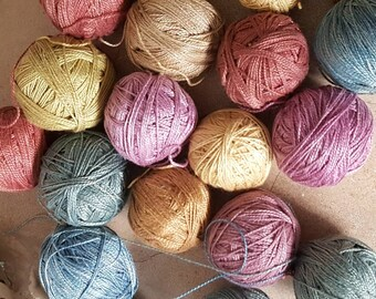 Hand dyed, plant colours threads.  Anchor no 8 weight