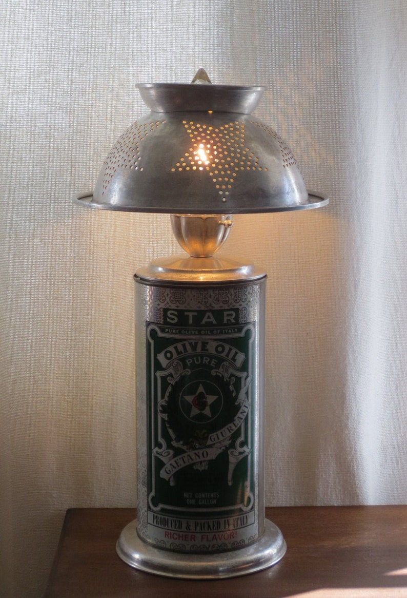 Stella Starbot colander and olive oil tin lamp image 0