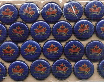 100 used, but undented, blue with red maple leaf beer bottle caps from Canada
