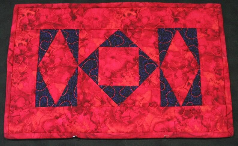 Red and purple batik diamonds placemat