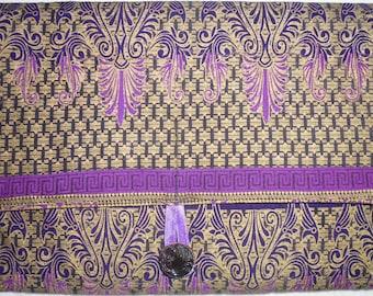 Purple, gold, and black clutch purse