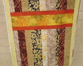 Yellow and orange crib or lap quilt, with orange horizontal stripes