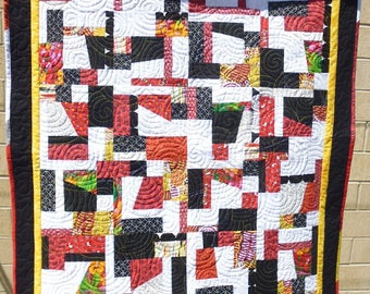 Crazy red, black, and white lap quilt