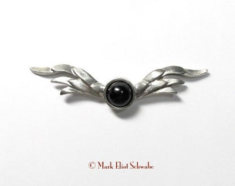 Wings with Onyx a lovely accent pin made in pewter by Mark Eliot Schwabe