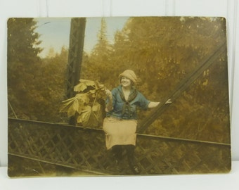 Colorized Photograph of a Young Woman on Bridge Rail, Waving Large Leaves, 1920's Snapshot