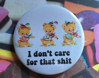 Vintage mash-up pin badge - I dont care for that sh*t