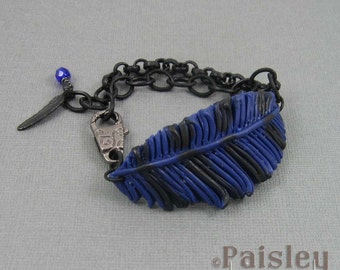 blue black polymer clay feather on matte black chain with lobster clasp Blue Jay feather bracelet