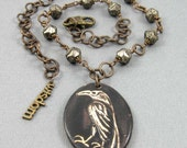 Wise Black Raven necklace, ceramic pendant on beaded chain with Czech glass and antiqued brass clasp, narrative jewelry