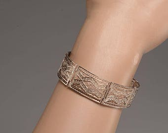 Silver Filagree Bracelet with 7 Hinged Panels, Intricate Design - Marked 800 Silver with a second illegible hallmark