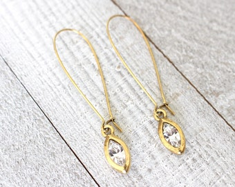 Long graceful gold earrings with crystal navette drops
