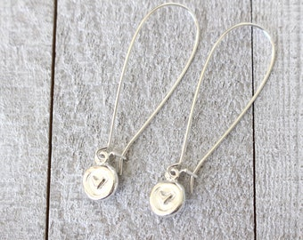 Long graceful silver earrings with heart circle charms