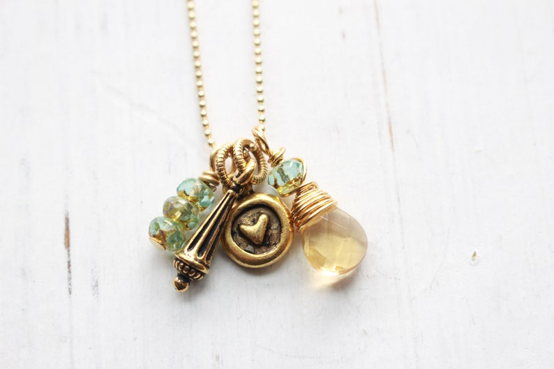 Gold necklace with cluster of charms gold ball chain with image 0