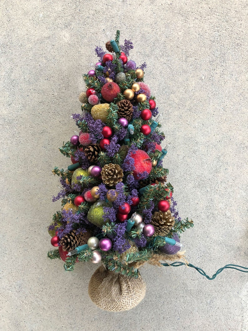 Purple Decorated Holiday Christmas Tree  Apples Flowers and image 0