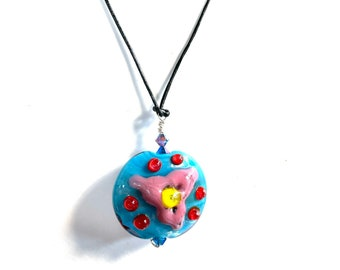 Lampwork pendant by Oimillie SRA UK glass artist Xmas gift present in bright blue and pink on leather thong
