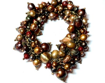 """Baroque Pearlescence Bracelet. Opulent, over the top 8"""" magnetic clasp bracelet. Over 100 wire wrapped excellent quality earthtoned pearls."""